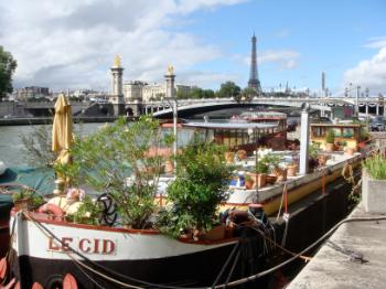 Photo from Paris with boat in the foreground and the Eifel Tower in the background